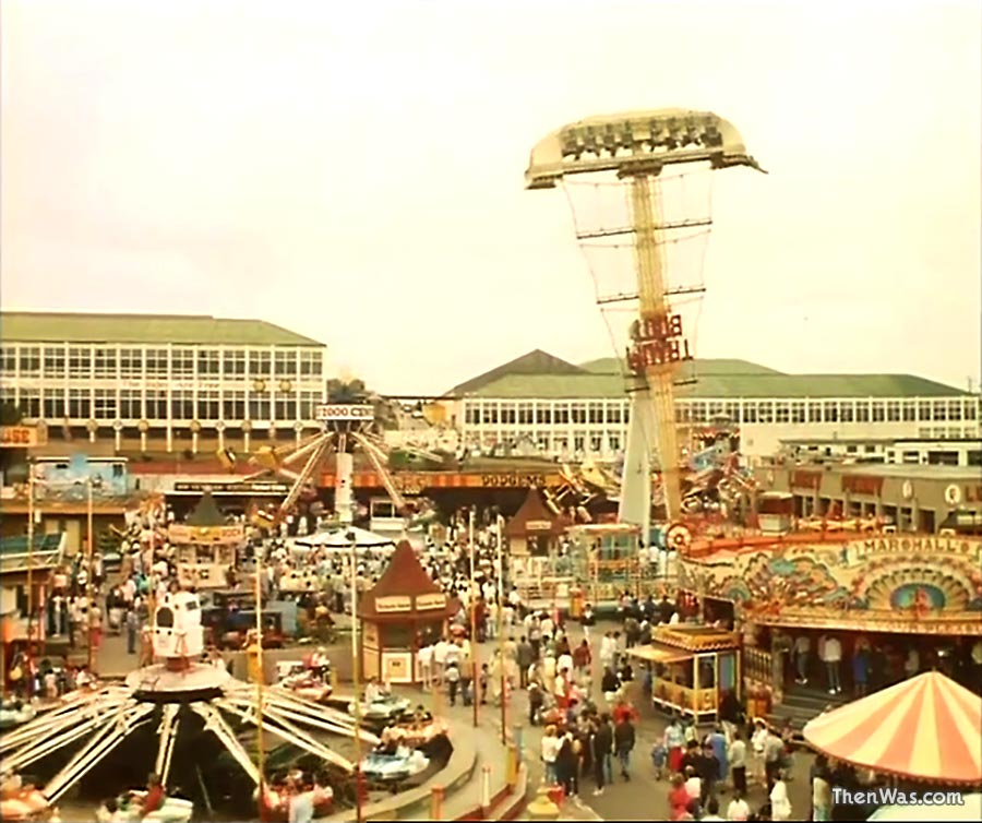 A wide view of the Fun Fair and the imposing Butlins buildings behind circa 1986 - Still from Bloody New Year