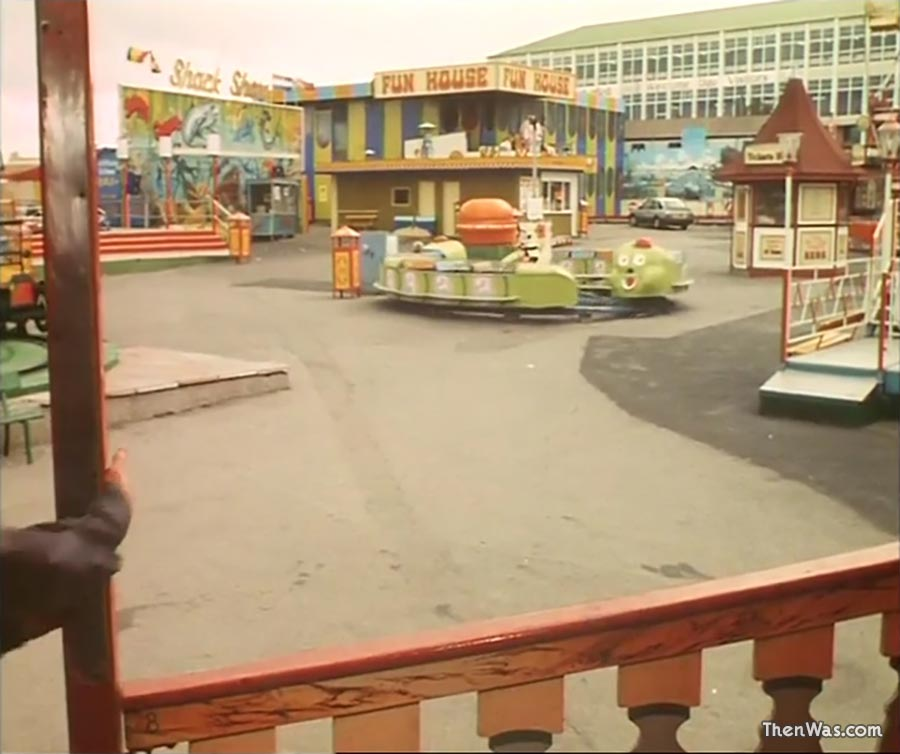 View of the Fun House with Butlins behind at Barry Island Fun Fair circa 1986 - Still from Bloody New Year.