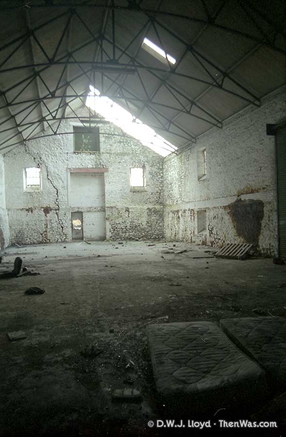 Interior of derelict workshop under the flyover
