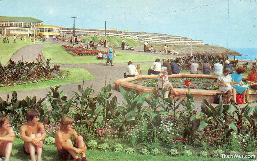 1970s view of the Promenade with flower beds and old ladies eating packed lunch