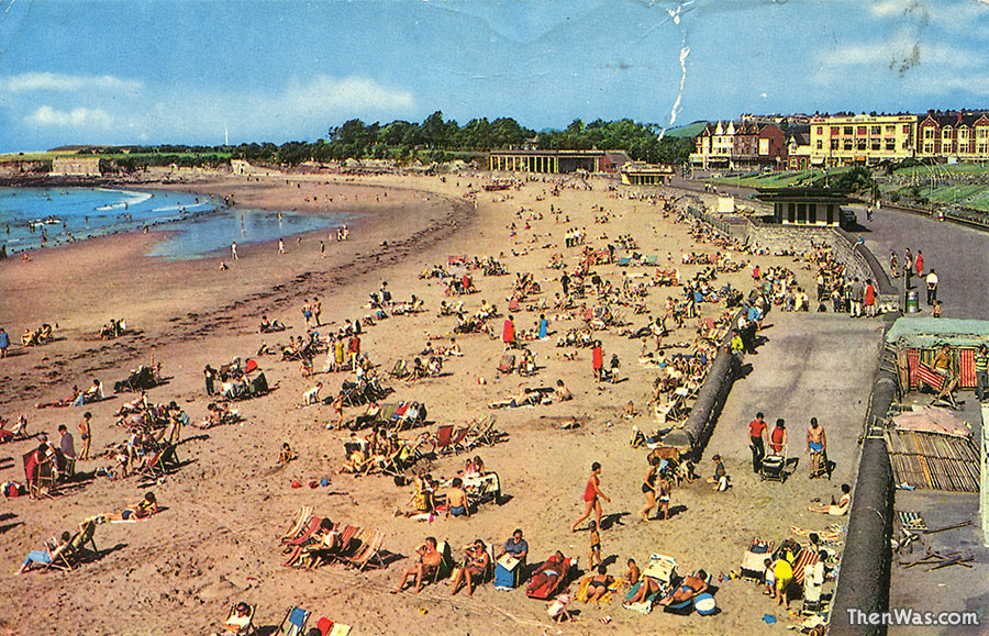1970s postcard of the beach, notice the old structures on Friars Point still in place.