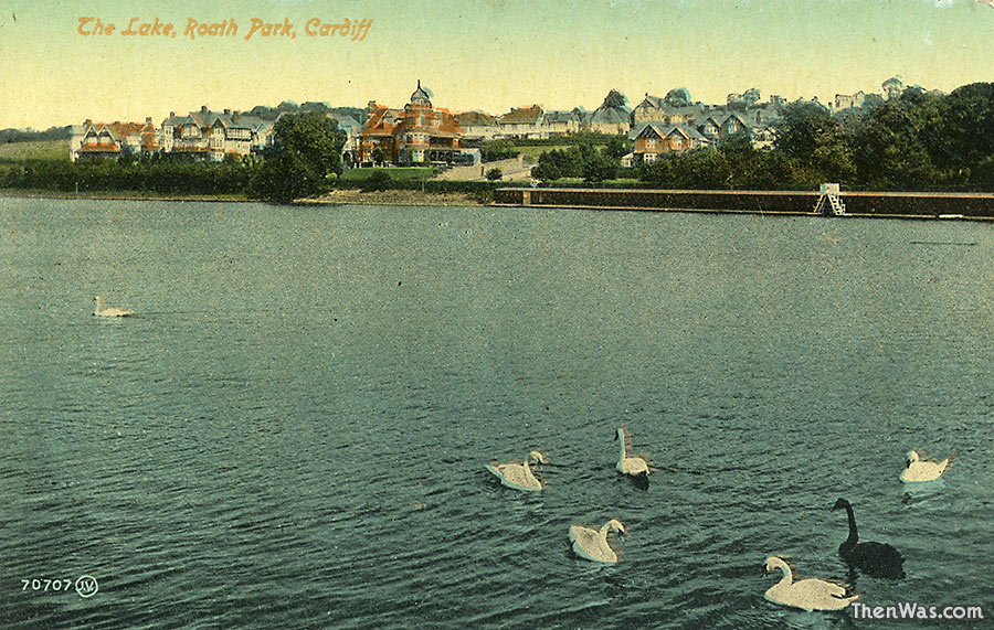 View across the lake to grand houses and surrounding fields - 1910s?